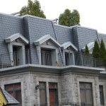 Rooftop terrace with mansard slate roof. Metal dormer walls. Saddle hip install.