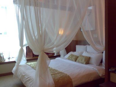 white bed curtains:) one day when I won't have children swinging from them.
