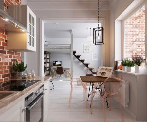 From the kitchen, earthier tones come into play. Scrumptious brick reds expose themselves in the kitchen, with wooden benches and a table to settle them. Table chairs in light brown plastic add modernity, while a white-framed enclave invites from the more-muted living room.