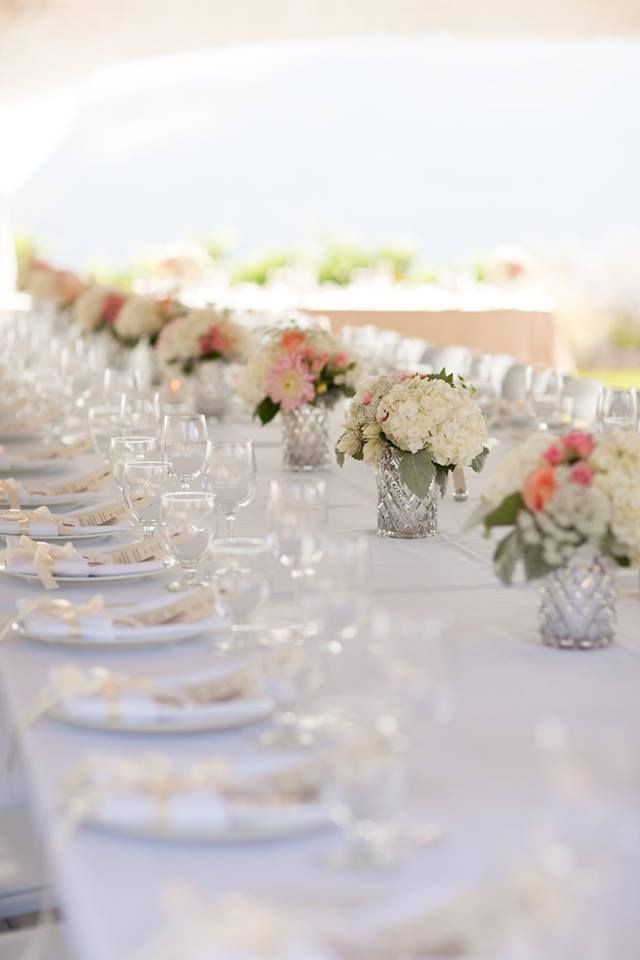 Reception centrepieces at the Lovely Painted Rock Winery.  Photo: Jarusha Brown Photography