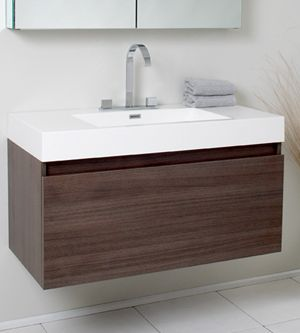 "The Fresca 39"" Mezzo Single Vanity is striking in its simplicity. Don't forget to check under the hood with the innovative storage system from Blum that includes a nested drawer. It also features a mirrored medicine cabinet that can be either wall mounted or recessed into a wall. Mirrored Medicine Cabinet includes adjustable shelves. Several free faucet styles to choose from. Optional side cabinets sold separately.<br /> <ul><b>Dimensions</b>: <li>Vanity: 39""W x ..."