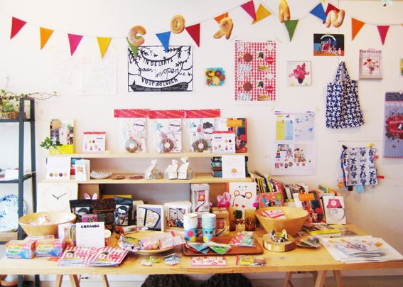 Craft fair table ~ I love how they've hung letter-shaped bread above the stall to spell a word.