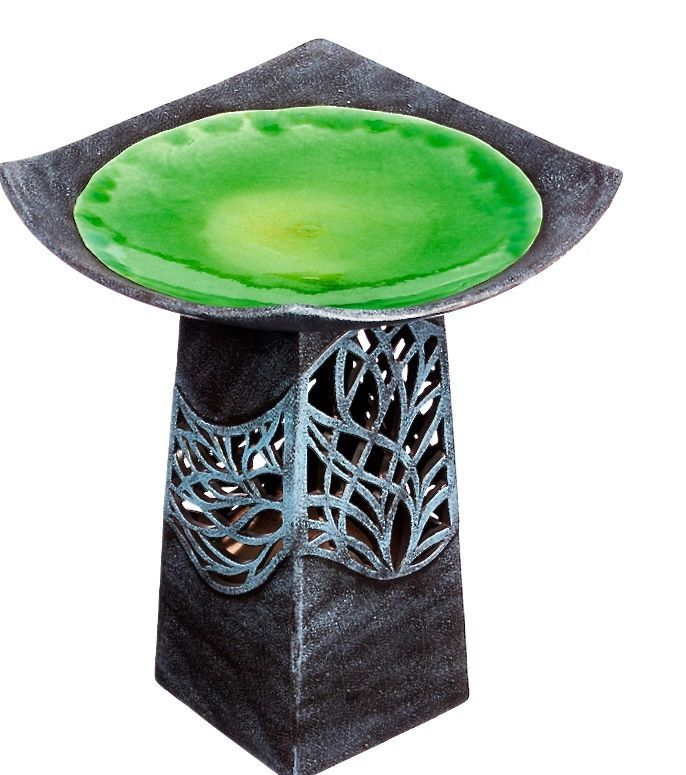 Unique bird bath with hand-glazed bowl and lighted base is bird-approved. Battery powered LED light glows through the intricate cut-out pedestal design. Asian inspired character lends itself to a peac