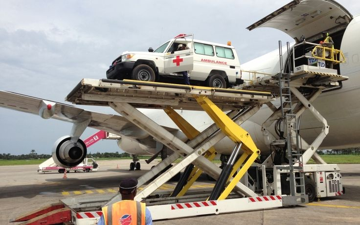 Thanks to World Bank funding to Sierra Leone, WFP airlifted ambulances and other vehicles to help in the Ebola response. (29 October 2014, Photo: WFP/Djaounsede Pardon Madjiangar)