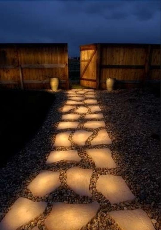 """Paint rocks with glow-in-the-dark paint (Rust-Oleum). During the day they """"charge"""" in the sun and in the evening they reflect stored light!"""