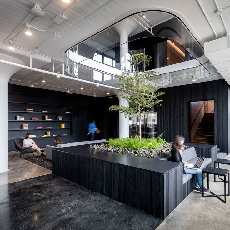 Black and white surfaces, indoor trees and a rooftop workspace all feature at the new headquarters for website building service Squarespace in New York.
