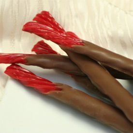 """Chocolate fountains and fondue aren't new, but chocolate-dipped foods that go beyond pound cake and strawberries are finding favor with … Food Network Magazine features their """"surprise hits"""" in the March 2012 issue: chocolate-dipped red licorice, toaster waffles, shredded wheat and corn chips are a few."""