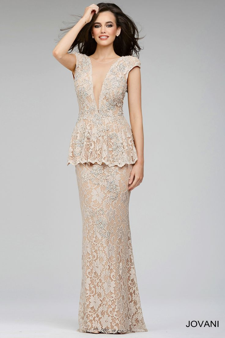 Embrace the lace in the stunningly chic Jovani 24834 evening dress. Beautiful beads subtly accent lace mesh over a nude lining in this exquisite full-length lace gown. The bodice features an open, plunging V-neckline, with high nude modesty inset. Cap sleeves extend to frame the open back. A gorgeous peplum flares from the natural waistline in figure flattering effect, and overhangs the long, elegant sheath skirt.