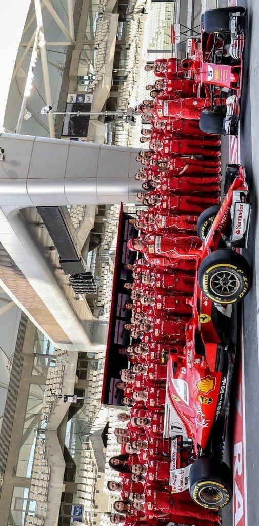 2017/11/23:Twitter: @sebvettelnews: Sebastian Vettel, Kimi Raikkonen, the 2017 cars and the Ferrari team today at Yas Marina. #AbuDhabiGP #F1 #Seb5