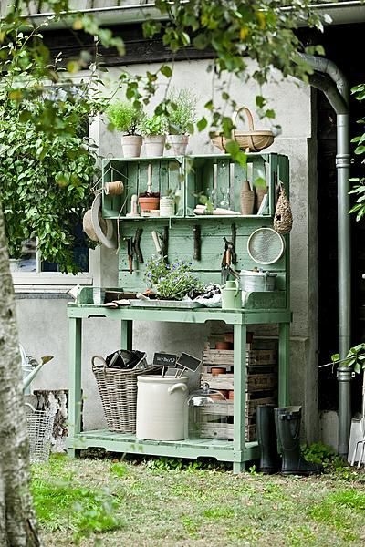 Potting table with crate shelves painted mintgreen ~ lovin it!