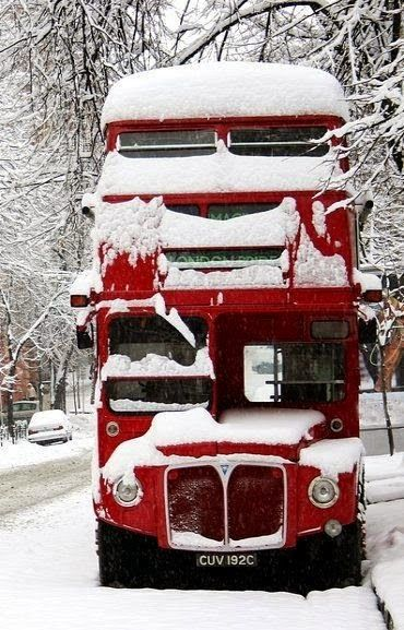 Snow covered red double-decker bus ~ England