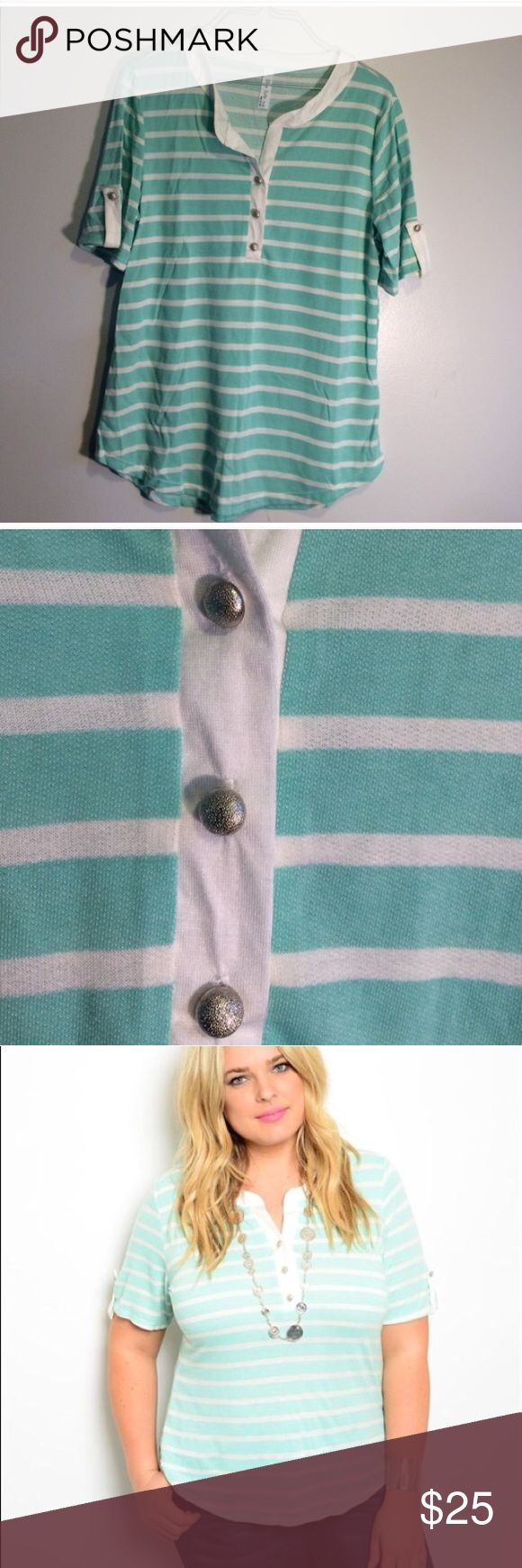 Plus sized Mint colored short sleeve top. Plus sized Mint colored short sleeve top. These run small I would say I'm an XL and in this top I wear a 1x comfortably. Material is 94% polyester 6% spandex. Has 3 silver colored plastic button on front of shirt and one on cuff of each sleeve to bring a little pop😊 Tops