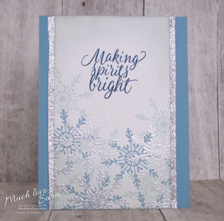 A flurry of snowflakes in shades of blue, with silver embossing, flutter across the bottom of this clean and simple holiday card.  Created with these Stampin' Up! products: Tin of Tags Stamp set, Glitter Ribbon Combo Pack.  Click through to see the rest of the supplies used.