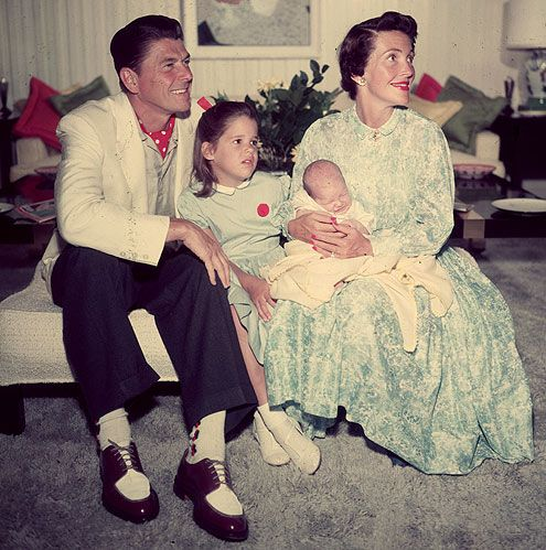 PATTI REAGAN  - Long before he was elected President, then-actor Ronald Reagan and his second wife Nancy pose with their children Patti (snuggling up to Dad) and Ron Jr. in 1955. Later, Patti's liberal views and rebellious behavior would make her somewhat of a black sheep in her conservative family, though she reconciled with her parents as Reagan struggled with Alzheimer's.