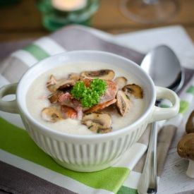 Cream of celeriac soup dressed up with bacon and garlic mushrooms. For these cold winter evenings!