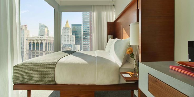 With awe-inspiring views of Manhattan's busy urban landscape, these queen-bedded rooms really showcase the city's splendor through wrap-around floor to ceiling windows. The thoughtful, contemporary design combines modern technology like 42-inch LED TVs, Bluetooth radio, and bedside USB charging stations, with warm walnut furnishings.