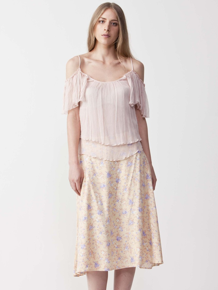 Jordyn - Cutout Chiffon Top with round neckline. Features spaghetti straps with chiffon sleeves. Regular fit and length. $49.5