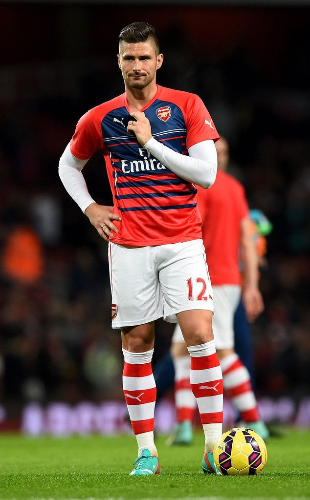 Olivier Giroud of Arsenal looks on as he warms up before the Barclays Premier League match between Arsenal and Manchester United at Emirates Stadium on November 22, 2014 in London, England.