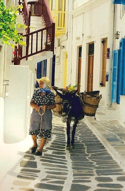So typical. the quiet, the donkey, the old comfortable clothes (Photo;The old lady and the donkey - #Mykonos Town, #Greece *Archaeologous.com offers private guided tours of #Delos and Mykonos