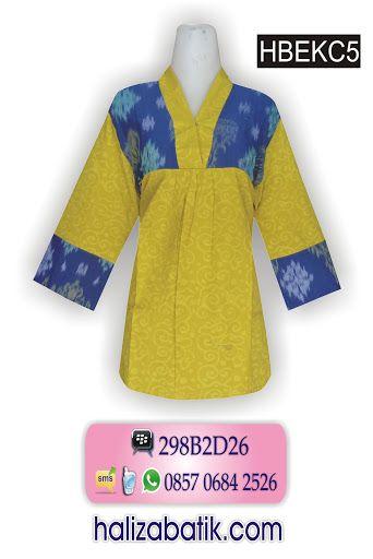 Batik modern. Atasan batik embos warna hijau pupus. Blus batik kombinasi tenun. Model batik lengan panjang 7/8. Blus kerah V dengan kancing ceplik.