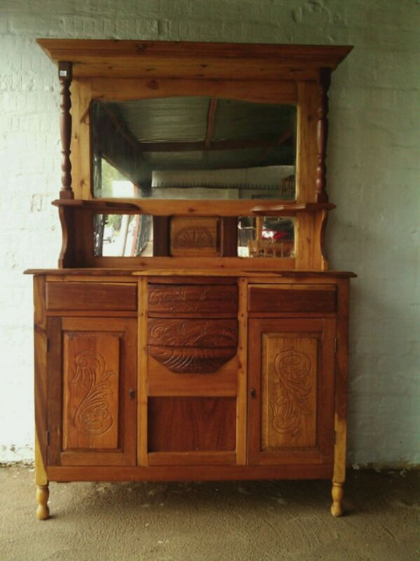 SOLD! #NorthcliffAntiques Sideboard. Sideboard Details: Top section, has two pillars with one large mirror and two small mirrors. The lower section has doors, one on the right and another on the left, with a drawer above each door and two drawers in the middle. Wood: Kiaat. Finish: Vanish and polish. #Johannesburg #Sideboard #DiningRoom #Kiaat #Antiques