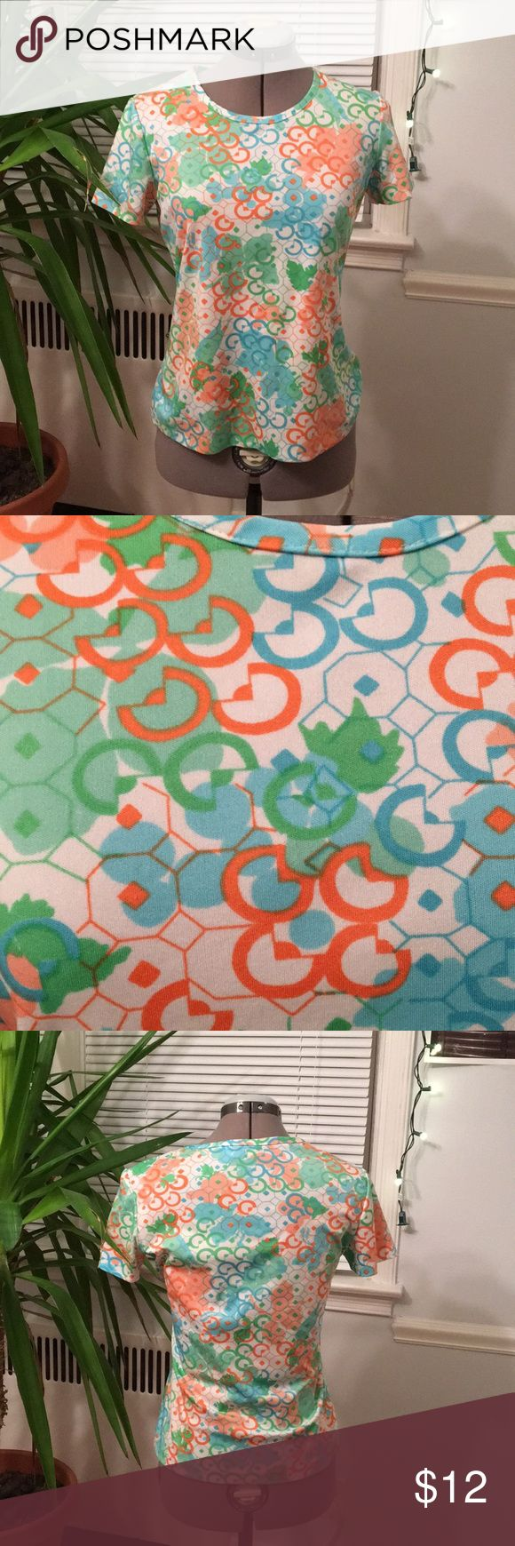 Vintage 70s Geometric Print T-Shirt Vintage tee with bright all over abstract geometric print.  Semicircles, octagons, and squares layer over a floral print in shades or orange, blue, and green. Rounded collar and short sleeves. Tag brand is Moore Bros. Sportwear. Size ladies Small. In good vintage condition, some frayed threads. Moore Bros. Sportswear Tops Tees - Short Sleeve