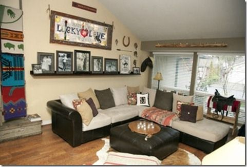 Pendleton blankets, an old western saddle, and Lucky in Love art dress up this western living room with color. | Stylish Western Home Decorating