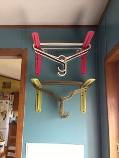 Put hangers in laundry room. This or maybe iron pipe?