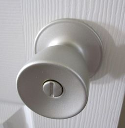 Spray painting door knobs... definitely a cheaper alternative to replacing the outdated brass!