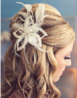 Love this wedding hair and that's a gorgeous accessory for a birdcage veil!