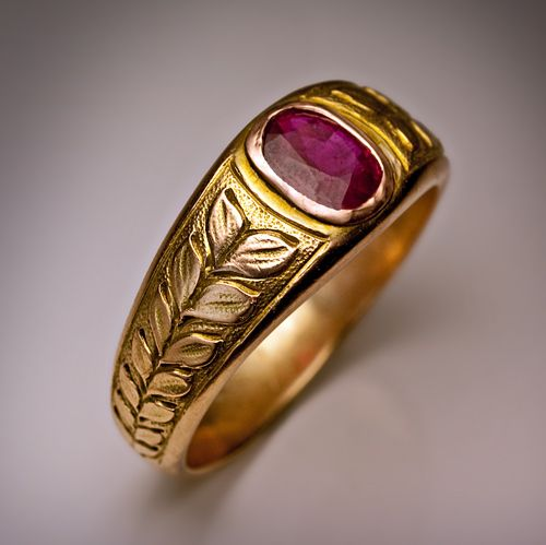 Vintage Men's Ruby Ring made in Moscow between 1908 and 1917. A greenish-yellow 14K gold ring designed as a laurel wreath tiara centered with a cushion cut natural ruby (approximately 1 carat) set in a rose gold bezel.