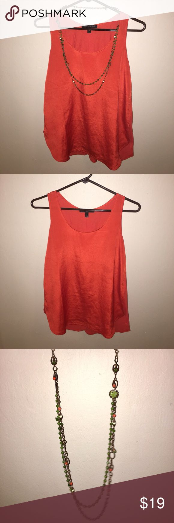 Banana Republic XS Orange Tank + Boho Necklace. Preowned Banana Republic XS Orange Tank + Boho Necklace. Tank and Necklace are separate pieces but I have paired them together since they go so well together. Tank is an XS but it does runs a bit on the big side. It is a loose fitting top that pairs well with leggings or tight jeans. Some very slight wear on the tank but it is in great, preowned condition. Necklace is also in great, preowned condition and is adjustable. Banana Republic Tops…