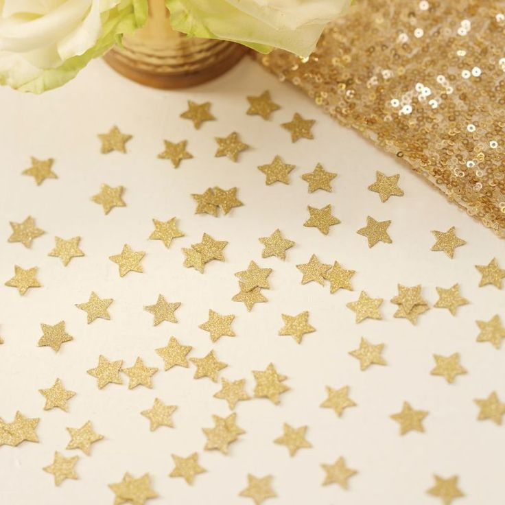 This gold glitter star confetti adds a touch of sparkle to a wedding or party! - Metallic Perfection at GingerRay.co.uk