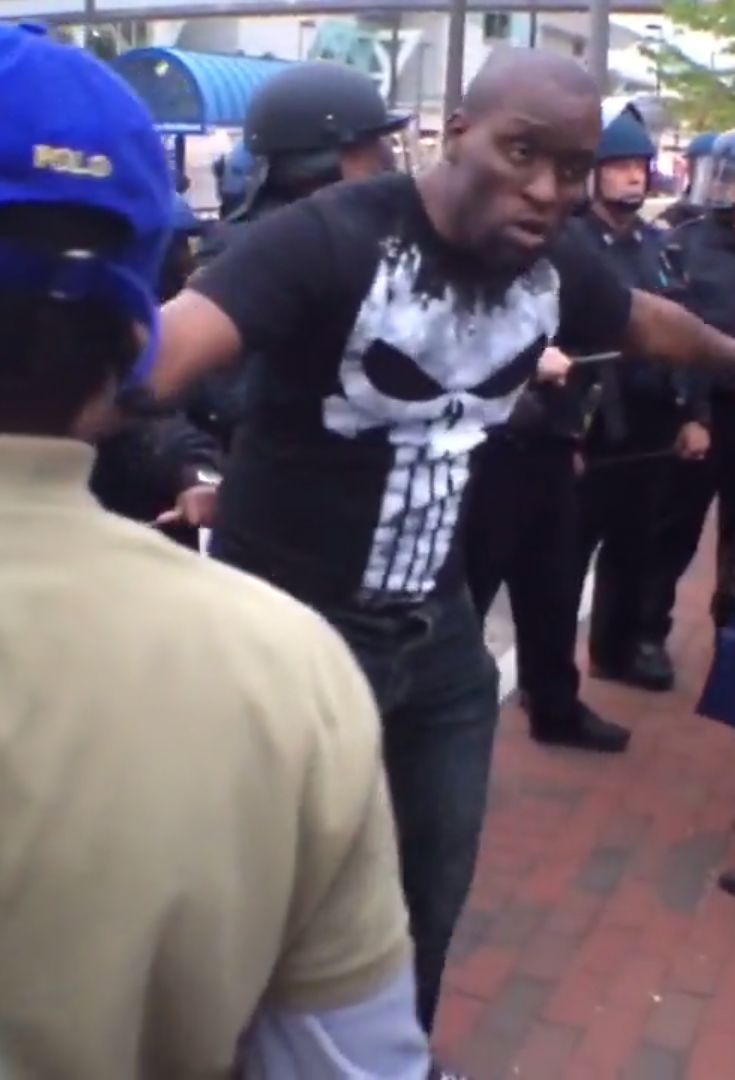 28 Moments That Show Another Side Of The Baltimore Riots //  This man gives me so much hope for humanity, standing in between rioters and police begging people to not start trouble