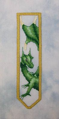 Green Dragon Bookmark - Cross Stitch Pattern by Dracolair Creations Model stitched on 28 count Stormy Gray (Marbled) Hand Dyed-Linen with DMC floss. Stitch count: 22w x 90h.   Cross Stitch Patterns - Item #11-1696