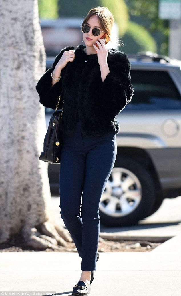 Dakota Johnson, 26, proved she does have a more eccentric side when she stepped out holdin...