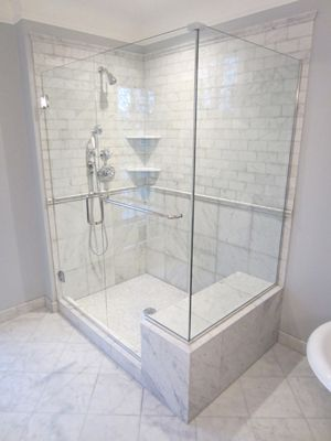 Great Idea for a shower re-do if you have gold framed showers with outdated fixtures and tiles. This is luxurious! - http://walkinshowers.org/top-5-walk-in-showers-with-seats.html