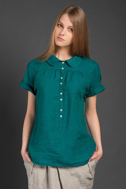 Dark bluish green summer blouse sewn from lightweight, thin, specially washed (it won't shrink after you wash it) 100% linen fabric. The blouse features short folded sleeves, a Peter Pan collar, and a row of buttons at the front. Tiny decorative pleats above the chest make it look more elegant and feminine. This lightweight hip-length blouse will make a perfect part of your casual summer outfit. // €80