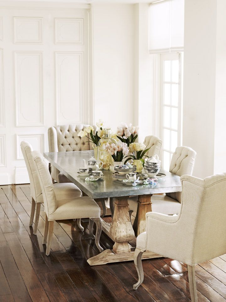 I love the double effect this dinning room has, elegance and casual at the same time. These white chairs would not survive.