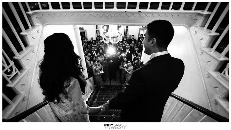 www.indysagoo.com  Just married and about to greet all their happy family and friends   #just #married #happy #family #love #friends #weddings #photography #leicester #cityrooms #black #white #indian #hindu #wedding