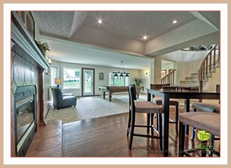 After professional home staging. This vacant area in the basement has been transformed into the perfect place to entertain family and friends.