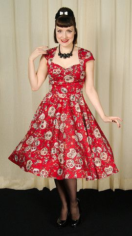 This is a perfect example of retro with an edge! This red swing dress features sugar skulls, flowers and bows all over in