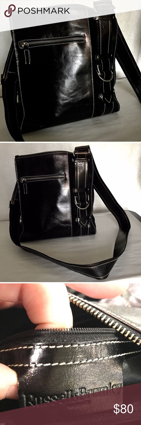 Russell & Bromley cross body purse Adorable Black cross body bag. Zipper and buckle detail on front. Inside and outside of purse great condition. Authentic bag. Two zipper pocket and one open pocket inside purse. Russell & Bromley Bags Crossbody Bags