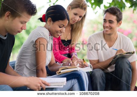 Friends and education, group of university students studying, reviewing homework and preparing test - stock photo