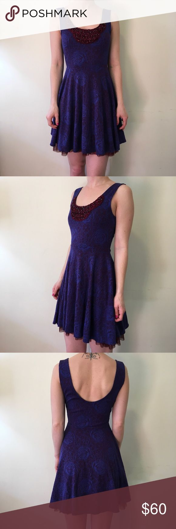 Free People Purple Red Skater Sleeveless Dress Free People Dress with a red and blue purple body that has Tulle underneath and is stretchy material! Super cute and unique- in good used condition! Free People Dresses