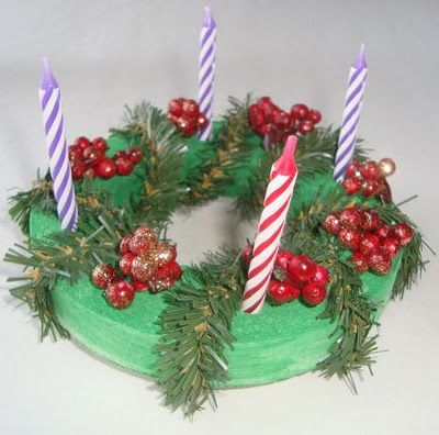 advent wreath craft - Dollar Tree white styrofoam circles (painted green) w/wired pine and berries glued on, purple and pink birthday candles; cut out center of circle & use screwdriver to poke holes for candles