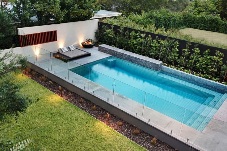 Frameless glass walls and simple contemporary pool and landscaping.