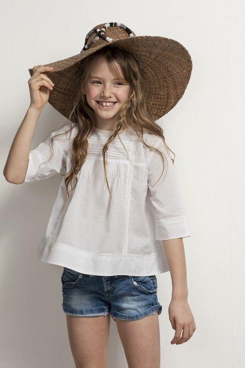 white blouse, shorts