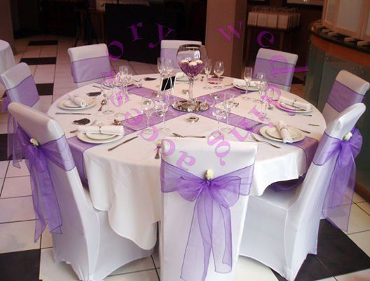 LOVE IT..this is how i want my table to look like :) & the centerpiece would have hints of green in it with the purple