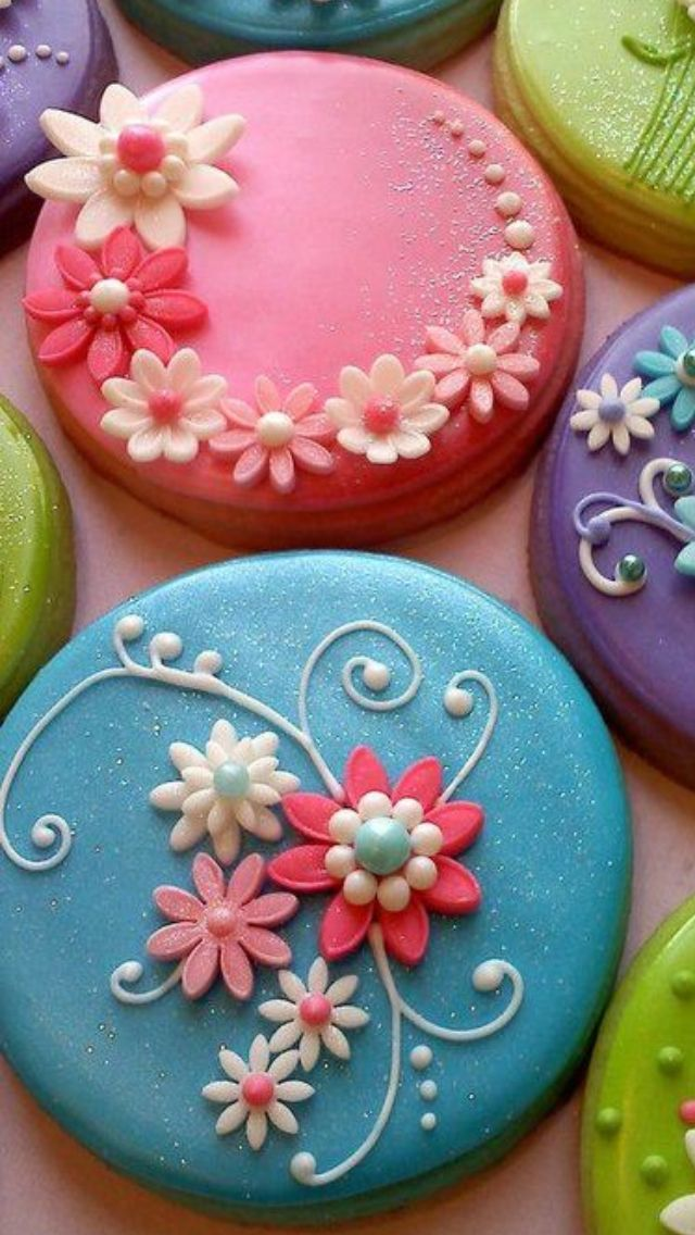 cute bright flower individual cakes with piped swirls. Have Happy Birthday piped…